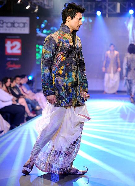 A model clad in dhoti kurta designed by Sharbari Datta.