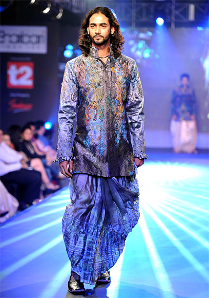 It took five years and a successful fashion show with Milind Soman clad in a coloured dhoti and jacket walking down the ramp to make men shed their inhibitions about donning colours.