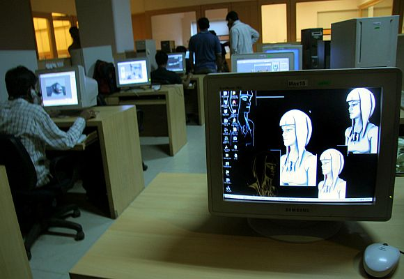 Indian animation designers work on a production floor.