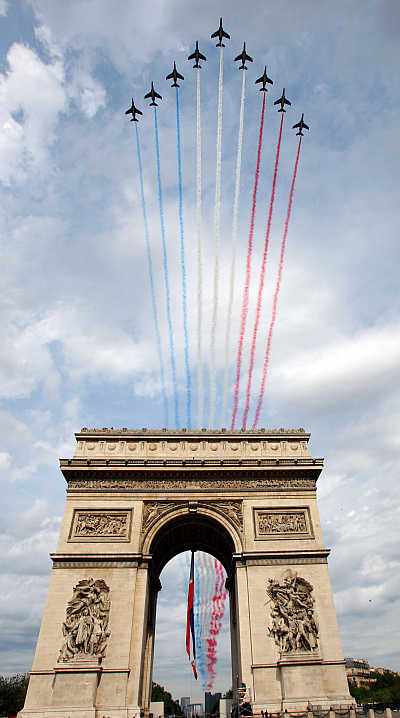 Fighter planes stream the red, white and blue colours of the French flag over Paris's Champs Elysees during the annual Bastille Day celebrations.
