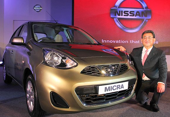 Kenichiro Yomura, President of Nissan India, poses with the new Nissan Micra, in Mumbai.