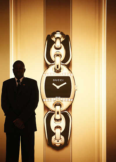 A security guard stands at the Gucci showcase at the opening of the Baselworld in Basel, Switzerland.