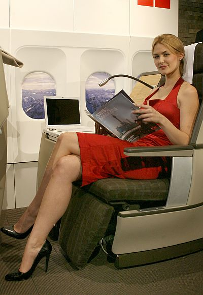 A model poses on a new business class seat on an international airlines.