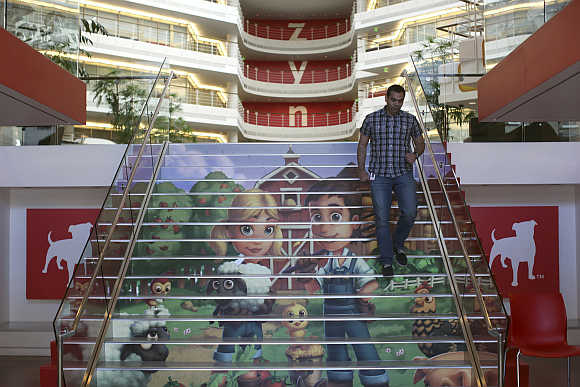 Player avatars from Zynga's FarmVille 2 are seen on a stairway at the entrance to Zynga headquarters in San Francisco, California.