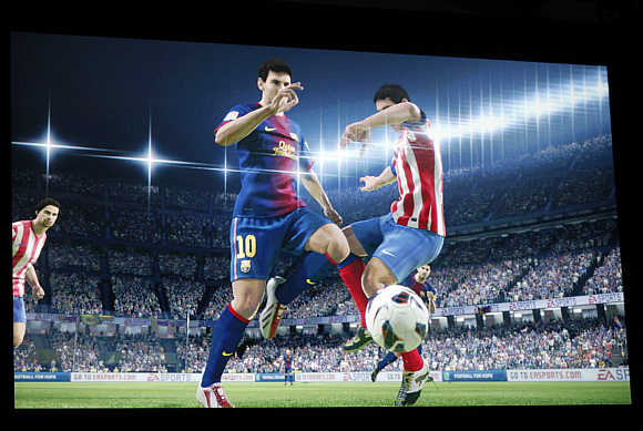 Fifa 14 Ultimate Team game on a screen during an unveiling of Microsoft's Xbox in Redmond, Washington.