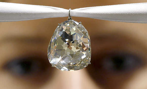 An employee of Sotheby's auctioneers displays the Beau Sancy diamond in Zurich, Switzerland. The historic 34.98 carat modified pear double rose cut diamond, which has an estimate of $2-4million, goes on auction in Geneva.