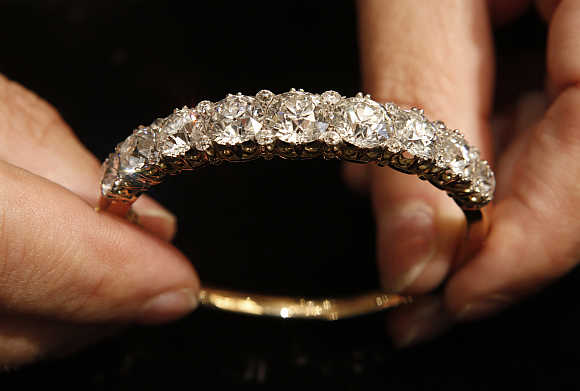 A 40-carat diamond bangle from the 1860s is displayed at Bentley and Skinner jewellers in London.