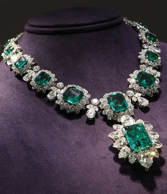 An emerald and diamond pendant and necklace by Bvlgari priced between $2.5 million to $3.5 million, which was a gift from Richard Burton to Elizabeth Taylor, on display in New York City.