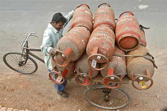 A worker loads Liquefied Petroleum Gas cylinders in Kolkata.