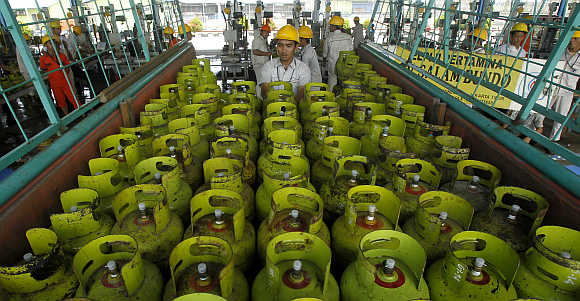 Workers upload LPG cylinders before sending to customers in Jakarta, Indonesia.