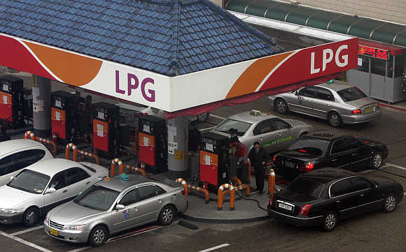 Vehicles fill up gas at a SK Energy's liquefied petroleum station in Seoul, South Korea.