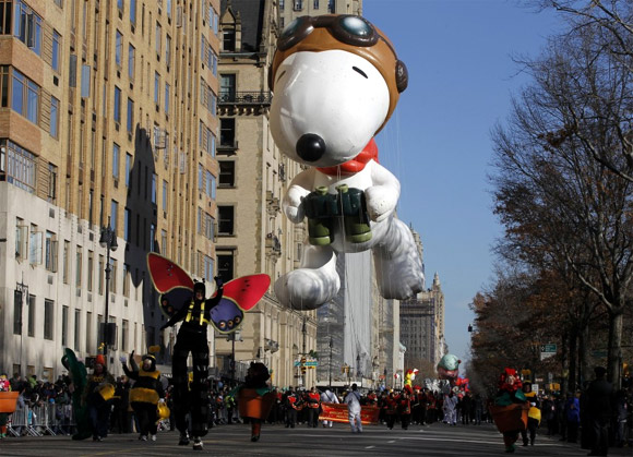 Snoopy the Flying Ace balloon floats down Central Park West during the 85th Macy's Thanksgiving Day parade in New York City.