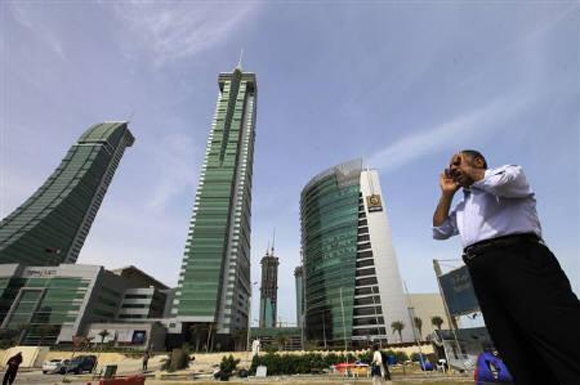 A person is seen standing at the junction of Bahrain Financial Harbour in Manama.