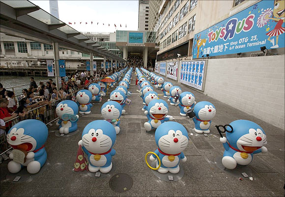 A gang of 100 different Doraemon figures are lined up in neat rows at HarbourCity in Hong Kong.