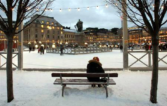 A visitor to the Kungstradgarden ice rink puts on her skates in downtown Stockholm.