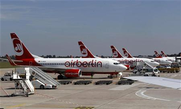 Air Berlin aircrafts stand on the tarmac at Berlin Tegel airport.