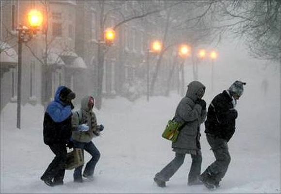 People walk in the street during a snow storm of Quebec City.