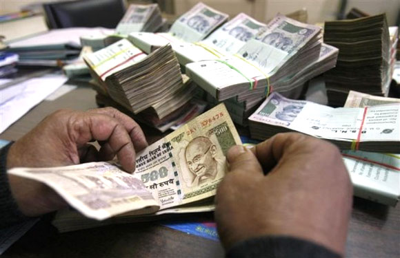 Rupee drops to record low of 61.21, recovers
