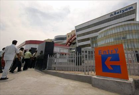 Employees of Satyam Computer Services, enter their head office in the southern Indian city of Hyderabad.