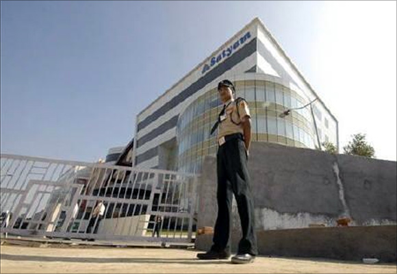 A security guard stands outside the head office of Satyam Computer Services in Hyderabad.