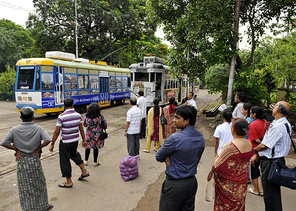Commuters wait to get on to the AC tram at the Esplanade tram depot.