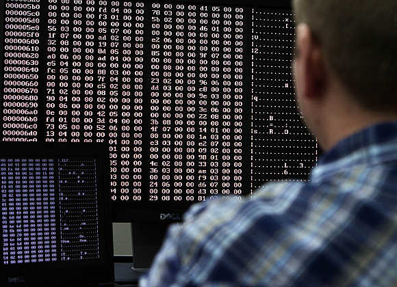 An analyst looks at code in the malware lab of a cyber security defense lab at the Idaho National Laboratory in Idaho Falls, Idaho.
