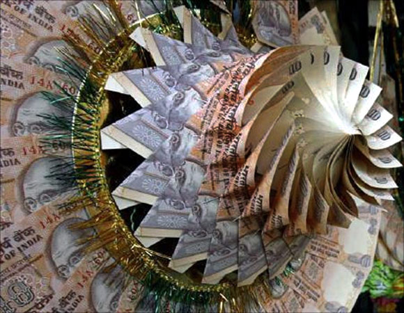 Rupee notes are stapled to form a garland at a market in Srinagar.