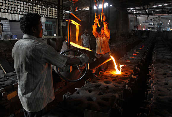 Workers tend to a furnace at a steel factory in the outskirts of Coimbatore.