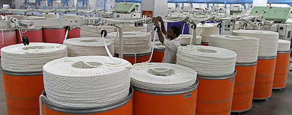 An employee inside a textile mill in Ahmedabad.