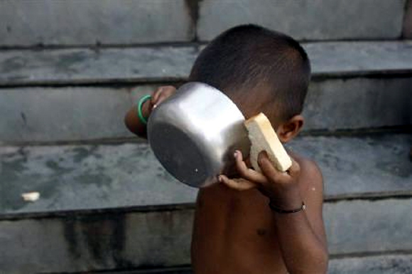 A child has his breakfast at a flood relief camp in Bihar's Purnia town.