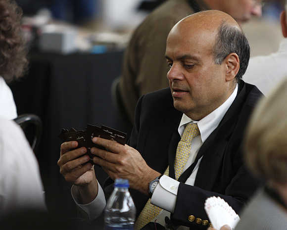 Ajit Jain plays a game of bridge during Berkshire Hathaway Shareholders annual meeting in Omaha, Nebraska.