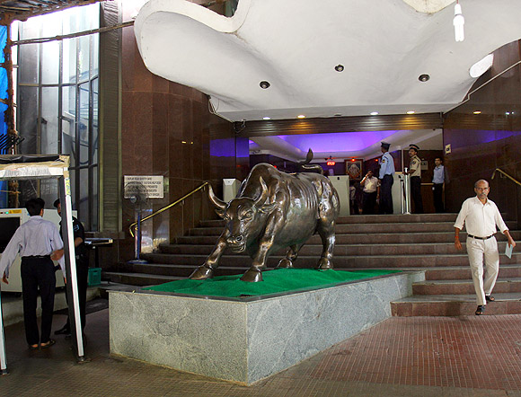 Sensex closes at record high of 21,034
