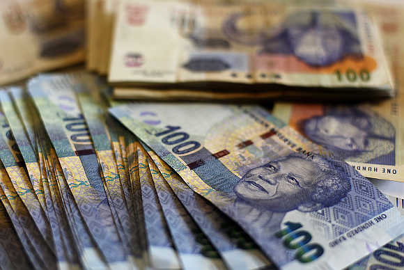 South African bank notes featuring an image of former president Nelson Mandela are displayed at an office in Johannesburg.