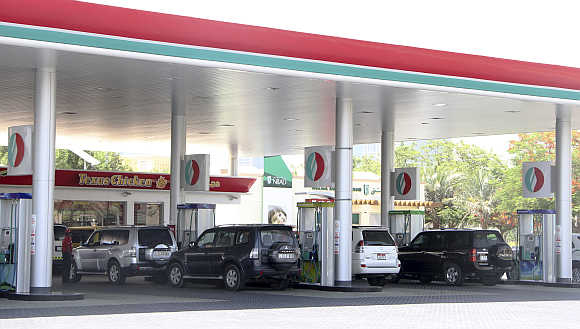 Cars queue for petrol in Dubai, United Arab Emirates.