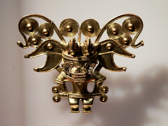 A piece of a gold breastplate in the shape of a bat-like man, is displayed at the exhibition.