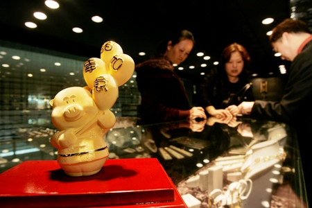 An ornament in the shape of a pig made of .9999 fine gold is displayed for sale at a jewellery store in Hong Kong.