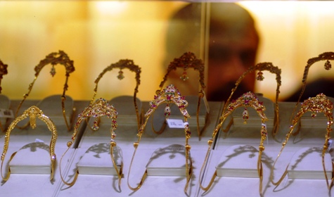 A shopkeeper looks at the gold ornaments in his shop in Chennai.