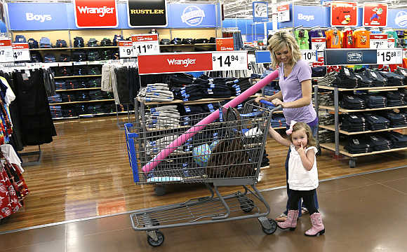 A woman shops with her daughter at a Walmart Supercenter in Rogers, Arkansas.