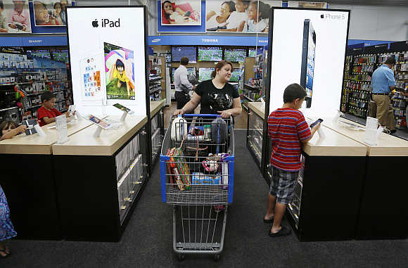 A customer looks over iPad and iPhone options at a Walmart Supercenter in Rogers, Arkansas.