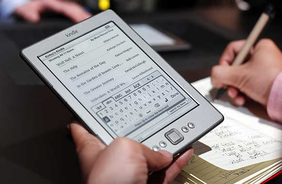 A reporter tries out a Kindle tablet in New York.