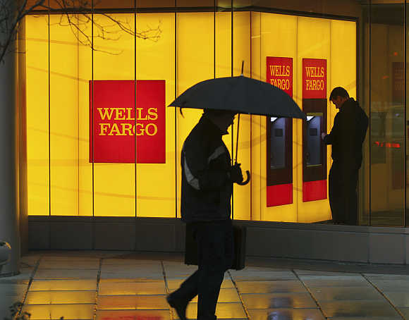 A man walks past a Wells Fargo branch in Washington, DC.