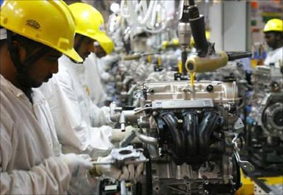 Employees work inside Maruti Suzuki's petrol engine plant on the outskirts of New Delhi.