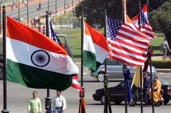 Indian and U.S. national flags flutter in New Delhi.