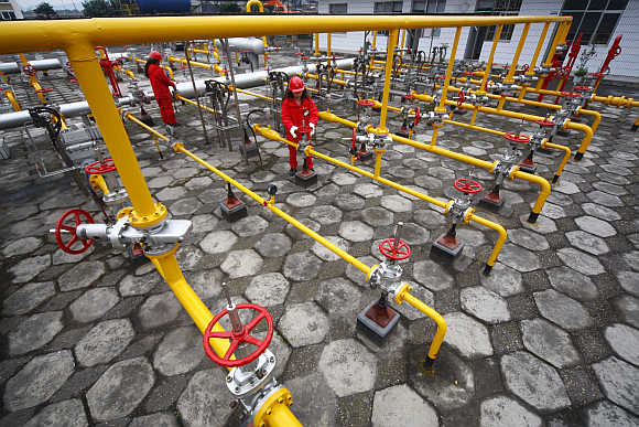 Employees of China National Petroleum Corporation carry out routine checks at a gas refinery in Suining, Sichuan province, China.