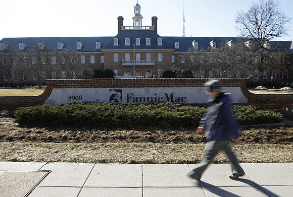 A woman walks past the Fannie Mae headquarters in Washington, DC.