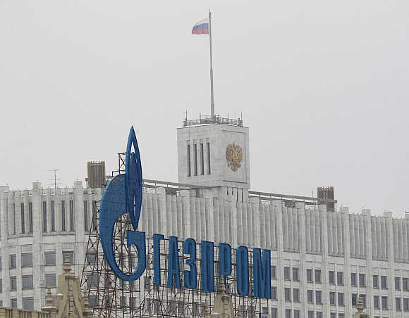 Gazprom logo on an advertisement in front of the White House in Moscow.