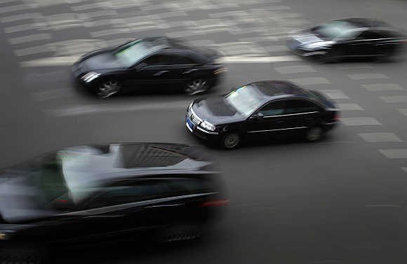 A Volkswagen Passat drives along a street in downtown Shanghai.