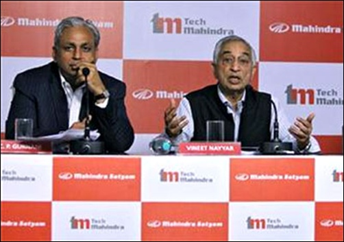 Vineet Nayyar (R), the chief executive of Tech Mahindra, speaks during a news conference as C P Gurnani (L), the chief executive officer of Mahindra Satyam looks on.