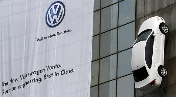 Volkswagen's Vento car hangs on display from a building during its launch in New Delhi.