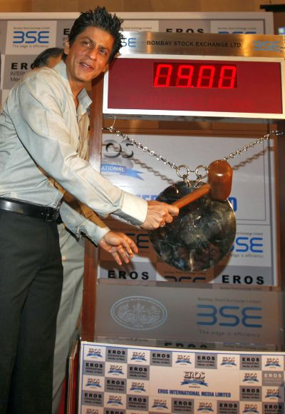 Bollywood actor Shah Rukh Khan poses before hitting the ceremonial gong during his visit to the Bombay Stock Exchange building.